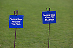Wealdstone 0 Newport County 0, 17/03/2012. St Georges Stadium, FA Trophy Semi Final. Signs asking players and spectators to keep off the pitch inside St Georges Stadium, home ground of Wealdstone FC, before the club played host to Newport County in the semi-final second leg of the F.A. Trophy. The game ended in a goalless draw, watched by a capacity crowd of 2,092 which meant the visitors from Wales progressed by three goals to one to the competition's final at Wembley, where they would meet York City. The F.A. Trophy was the premier cup competition for non-League clubs in England and Wales affiliated to the Football Association. Photo by Colin McPherson.