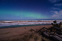 The Northern Lights over a partially frozen Lake Superior shoreline. Marquette, MI