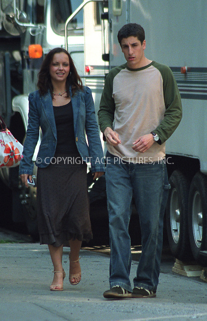"""Christina Ricci and Jason Biggs on the set of Woody Allen's film which has a project title """"Anything Else"""" or """"Woody Allen's Summer 2002 Project"""" in West Village in New York. June 19, 2002. Please byline: Alecsey Boldeskul/NY Photo Press.   ..*PAY-PER-USE*      ....NY Photo Press:  ..phone (646) 267-6913;   ..e-mail: info@nyphotopress.com"""