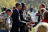 United States President Barack Obama (2-L) and First Lady Michelle Obama (C) greet veterans and their families on Veteran's Day, while visiting Section 60 of Arlington National Cemetery, in Arlington, Virginia, USA, 11 November 2012. Section 60 is the final resting place for the majority of casualties at Arlington National Cemetery that died from Operation Iraqi Freedom in Iraq and Operation Enduring Freedom in Afghanistan..Credit: Michael Reynolds / Pool via CNP