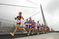 26 SEP 2004 - SWANSEA, SOUTH WALES, UK - Ana Burgos leads the elite, and under 23, womens fields across the Sail Bridge at the European Duathlon Championships. (PHOTO (C) NIGEL FARROW)