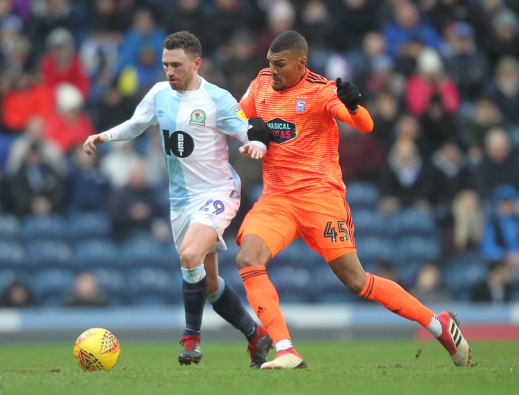 Blackburn Rovers Corry Evans battles with  Ipswich Town's Collin Quaner<br /> <br /> Photographer Mick Walker/CameraSport<br /> <br /> The EFL Sky Bet Championship - Blackburn Rovers v Ipswich Town - Saturday 19 January 2019 - Ewood Park - Blackburn<br /> <br /> World Copyright © 2019 CameraSport. All rights reserved. 43 Linden Ave. Countesthorpe. Leicester. England. LE8 5PG - Tel: +44 (0) 116 277 4147 - admin@camerasport.com - www.camerasport.com