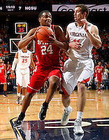 North Carolina State forward T.J. Warren (24) drives past Virginia forward Evan Nolte (11) during the game Saturday in Charlottesville, VA. Virginia defeated NC State 58-55.