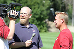Craig Lawson (left), Washington State soccer SID, interviews Cougar head soccer coach, Matt Potter (right), following practice at the Lower Soccer Field in Pullman, Washington, on August 12, 2010.