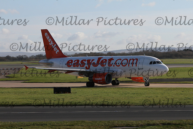 An easyJet Airbus A319-111 Registration G-EZNC taxying at Manchester Airport on 14.2.16 bound for Vienna International Airport.