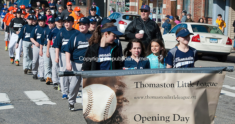 THOMASTON,  CT--- -041616JS05--Members of the Thomaston Little League make their way from Seth Thomas Park to Reeves Field in Thomaston during the annual parade on Saturday. <br /> Jim Shannon Republican-American