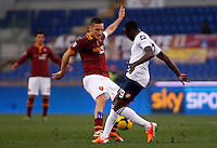Calcio, Serie A: Roma-Genoa. Roma, stadio Olimpico, 12 gennaio 2014.<br /> AS Roma forward Francesco Totti is challenged by Genoa midfielder Cabral, of Switzerland, during the Italian Serie A football match between AS Roma and Genoa, at Rome's Olympic stadium, 12 January 2014. <br /> UPDATE IMAGES PRESS/Isabella Bonotto