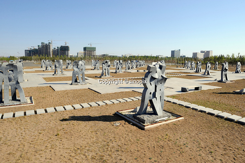 """Scuptures named """"Embrace of Love"""" in Kangbashi district of the Chinese city of Ordos, Inner Mongolia. 12-May-2011"""
