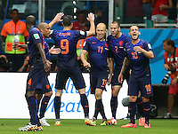 Arjen Robben of Netherlands celebrates with team mates after scoring his goal to make it 1-2