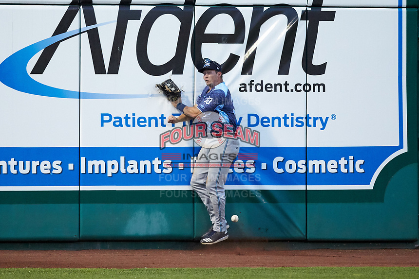 West Michigan Whitecaps left fielder Dayton Dugas (33) crashes into the wall while trying to catch a fly ball during the game against the Fort Wayne TinCaps at Parkview Field on August 5, 2019 in Fort Wayne, Indiana. The TinCaps defeated the Whitecaps 9-3. (Brian Westerholt/Four Seam Images)