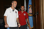 """9 September 2008: US Men's soccer head coach Bob Bradley (USA) (left) and player Landon Donovan (USA) (right) prepare to address the media. US Soccer held a press conference in preparation for their semifinal round World Cup Qualifying match against Trinidad and Tobago.  The press conference was held at """"Soccer House"""", the US Soccer offices in Chicago, Illinois."""
