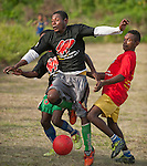 """Lobo Village loves nothing better than a soccer match. Players show off new uniforms gifted by RARE Conservation The t-shirts read: """"If fish are finished, what will we eat?"""""""