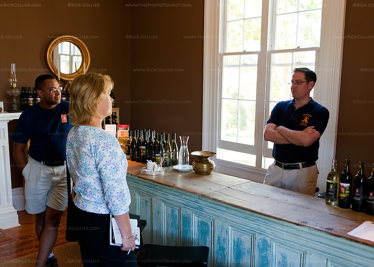 Nancy chats with owners Mike and Steven in the tasting room at Annefield Plantation.