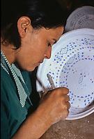 Ceramics, Nabeul, Tunisia.  Woman Painting Berber Design on Ceramic.  Le Caravane Workshop.