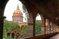 Dome of Templo de la Concepcion church and interior of the courtyard of  the Escuela de Bellas Artes or El Nigromante in San Miguel de Allende, Mexico. San Miguel de Allende is a UNESCO World Heritage Site.....