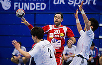 05 APR 2012 - LONDON, GBR - Tunisia's Haykel Megannem (TUN) (left) passes during the men's 2012 London Cup match against South Korea at the National Sports Centre in Crystal Palace, Great Britain (PHOTO (C) 2012 NIGEL FARROW)