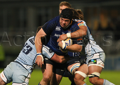 .27.10.2012 Dublin, Ireland. Mike Ross is tackled by Dafydd Hewitt and Josh Navidi of Cardiff Blues, during the RaboDirect PRO12 game between Leinster and Cardiff Blues from the Royal Dublin Society.