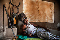 Witchdoctor Siasso Jamo (45) in his 'hospital' house. Jamo is one of the leaders of the district's Mozambican traditional healer's association AMETRAMO. He is possessed by three spirits and has been a traditional healer since 1990.
