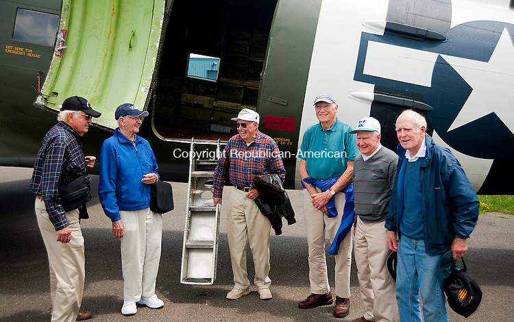 OXFORD, CT 11 JUNE 2013--061113JS07-Local WWII Veterans, from left,  Norman Taylor of Woodbury; Bernie Beauchamp of Watertown; Henry Long of Watertown; Dr, Craig Shealy of Woodbury; Bill Long of Watertown and John Benson of Woodbury gather for a group photo following their flight Tuesday in a vintage C-47 through New York City, past the new Freedom Tower and the Statue of Liberty before returning to Waterbury-Oxford Airport. <br /> Jim Shannon Republican American