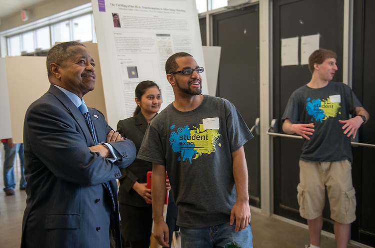 Ohio University President Roderick McDavis talks with student Keith Hawkins about his research at the Student Expo at the Convo on Thursday, April 11, 2013. Photo by Ben Siegel
