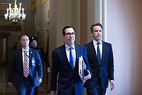 United States Secretary of the Treasury Steven T. Mnuchin walks to the Reception Room at the United States Capitol in Washington D.C., U.S. on Tuesday, March 24, 2020.  The Senate is working to finalize a deal on the Coronavirus Stimulus Package, after it was blocked by Senate Democrats two days in a row.  Credit: Stefani Reynolds / CNP/AdMedia