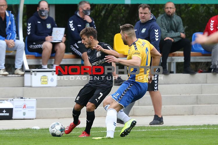 12.09.2020, JODA Sportpark, Todesfelde, GER, DFB-Pokal Runde1 SV Todesfelde vs. VfL Osnabrueck <br /> <br /> DFB REGULATIONS PROHIBIT ANY USE OF PHOTOGRAPHS AS IMAGE SEQUENCES AND/OR QUASI-VIDEO.<br /> <br /> im Bild / picture shows<br /> Bashkim Ajdini (VfL Osnabrueck) im Zweikampf gegen Morten Liebert (SV Todesfelde) im Hintergrund Trainer Sven Tramm (SV Todesfelde) <br /> <br /> <br /> Foto © nordphoto / Tauchnitz