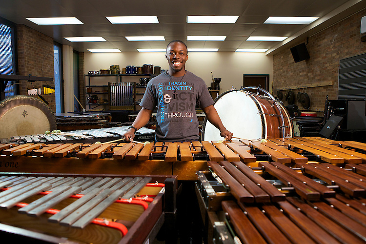 DePaul University senior Josh Jones stands in a sea of percussion instruments, mainly marimbas April 24, 2014. The cheerful and passionate musician looks forward to his future after graduating where he will continue to pursue his childhood passion as he joins Detroit's Symphony Orchestra. (DePaul University/Jeff Carrion)