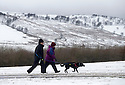 "28/03/16 <br /> <br /> Walkers near Grinlow Tower, Buxton.<br /> <br /> Holiday makers camping in the Derbyshire Peak District woke up to an unexpected white blanket this morning, thanks to Storm Katie.<br /> The covering of snow meant that many campers cut short their plans for a long weekend away, to brave the icy roads and head home early on Monday morning.<br /> But it wasn't all bad news for some of the younger guests at Grin Low Caravan Site in Buxton.<br /> Three-year-old Greta Williams made the most of the morning's surprise by building a snowman and enjoying snowball fights with her aunt Claire Jones. <br /> Claire said it was the first time she had been camping in the snow. <br /> ""It was completely unexpected but it's made it a trip to remember,""she said. <br /> ""Greta really enjoyed making the snowman, but I think we'll head back home now in case any more falls.""<br /> For Chris and Lorraine McCoy the first they knew of the snow was when they woke up and stuck their heads out of their tent.<br /> They had travelled to Buxton from Warwickshire with their four-year-old son Joe, to enjoy a weekend break.<br /> ""It's all part of the adventure,"" said Chris. ""It's a bit cold in the tent but we'll soon warm up, and it's made the surrounding countryside really beautiful.""<br /> <br /> All Rights Reserved: F Stop Press Ltd. +44(0)1335 418365   +44 (0)7765 242650 www.fstoppress.com"