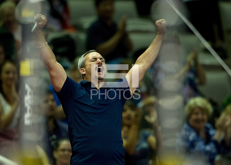 Danell Leyva's head coach Yin Alvarez celebrates after Danell performed well on the high bar during the 2012 US Olympic Trials competition at HP Pavilion in San Jose, California on June 28th, 2012.