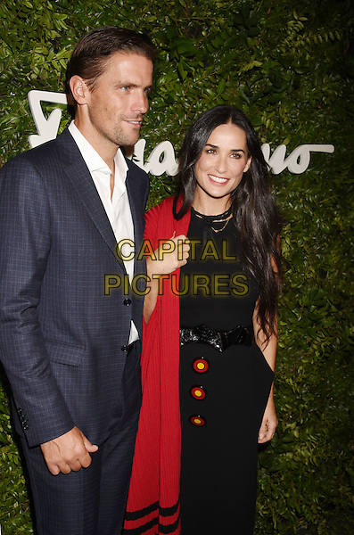 BEVERLY HILLS, CA - SEPTEMBER 09: Leather Product Director for Salvatore Ferragamo, Italia James Ferragamo (L) and actress Demi Moore arrive at the Salvatore Ferragamo 100 Years In Hollywood celebration at the newly unveiled Rodeo Drive flagship Salvatore Ferragamo boutique on September 9, 2015 in Beverly Hills, California.<br /> CAP/ROT/TM<br /> &copy;TM/ROT/Capital Pictures