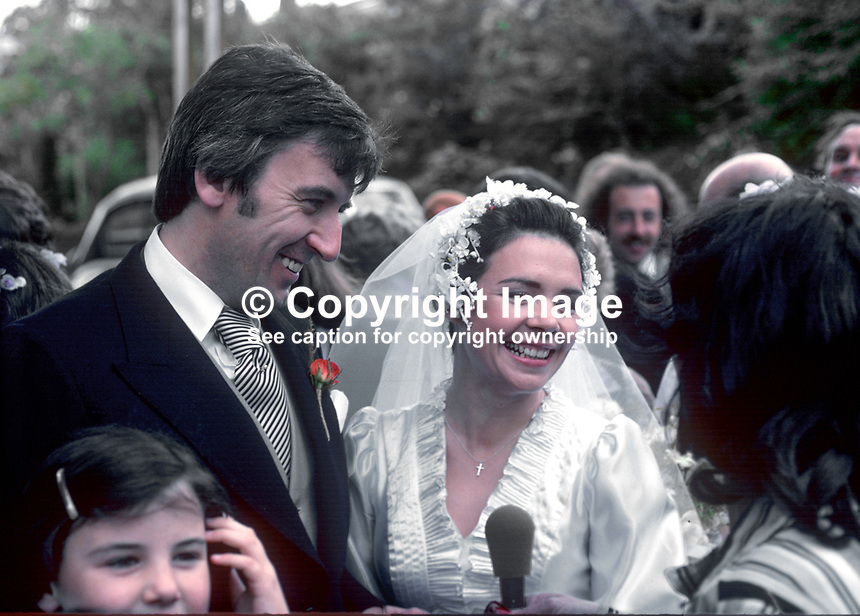 Wedding of Irish 1970 Eurovision-winning singer, Dana, aka Rosemary Brown, from Londonderry, N Ireland, and Damien Scallon, hotelier, Newry, N Ireland, in St Eugene's Cathedral, Londonderry on 5th October 1978. Bride and groom being interviewed at their reception hotel. 197810050265b.<br /> <br /> Copyright Image from Victor Patterson,<br /> 54 Dorchester Park, <br /> Belfast, UK, BT9 6RJ<br /> <br /> t1: +44 28 9066 1296 (from Rep of Ireland 048 9066 1296)<br /> t2: +44 28 9002 2446 (from Rep of Ireland 048 9002 2446)<br /> <br /> m: +44 7802 353836<br /> <br /> e: victorpatterson@me.com<br /> www.victorpatterson.com<br /> <br /> Please see my Terms and Conditions of Use at www.victorpatterson.com. It is IMPORTANT that you familiarise yourself with them.<br /> <br /> Images used on the Internet must be visibly watermarked i.e. &copy; Victor Patterson<br /> within the body of the image and copyright metadata must not be deleted. Images <br /> used on the Internet have a size restriction of 4kbs and will be chargeable at current<br />  NUJ rates unless agreed otherwise.<br /> <br /> This image is only available for the use of the download recipient i.e. television station, newspaper, magazine, book publisher, etc, and must not be passed on to any third <br /> party. It is also downloaded on condition that each and every usage is notified within 7 days to victorpatterson@me.com<br /> <br /> The right of Victor Patterson to be identified as the author is asserted in accordance with The Copyright Designs And Patents Act (1988). All moral rights are asserted.