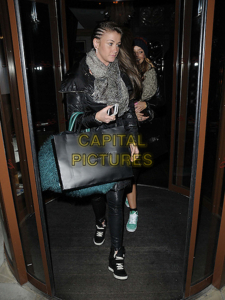 Brooke Vincent.attended the Pretty Little Thing s/s 2013 collection launch party, Sanctum Soho Hotel, London, England..January 16th, 2013.full length black leather jacket trousers goody bag grey gray scarf door braids plaits hair .CAP/CAN.©Can Nguyen/Capital Pictures.