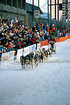 Alaska: Winter in Alaska.  Photo akwint105.  Dog race in Anchorage.  .Photo copyright Lee Foster, 510/549-2202,  lee@fostertravel.com, www.fostertravel.com