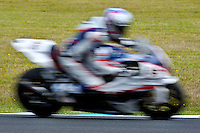 PHILLIP ISLAND, 27 FEBRUARY - Ayrton Badovini (ITA) riding the BMW S1000 RR (86) of the BMW Motorrad Italia SBK Team flahses past in a blur during race one of round one of the 2011 FIM Superbike World Championship at Phillip Island, Australia. (Photo Sydney Low / syd-low.com)