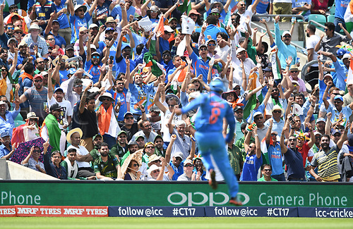 June 18th 2017, The Kia Oval, London, England;  ICC Champions Trophy Cricket Final; India versus Pakistan; Fans celebrate as Ravindra Jadeja of India jumps in celebration of the wicket of Fakhar Zaman of Pakistan