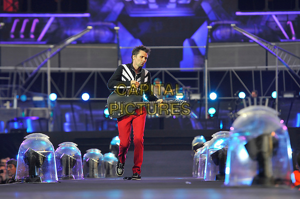 Matt Bellamy of Muse.Muse perform live in concert, Emirates Stadium, London, England, UK,.25th May 2013..music gig on stage performance performing full length red trousers guitar playing black white top jacket .CAP/MAR.© Martin Harris/Capital Pictures.
