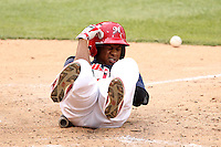 Memphis Redbirds outfielder Adron Chambers #4 reacts after getting hit by a pitch in the elbow during a game versus the Round Rock Express at Autozone Park on April 30, 2011 in Memphis, Tennessee.  Memphis defeated Round Rock by the score of 10-7.  Photo By Mike Janes/Four Seam Images