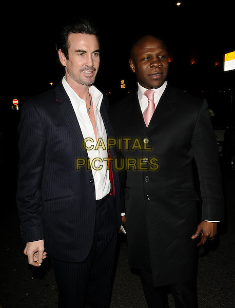 GARY STRETCH & CHRIS EUBANK.The Select Model Management Oscars Party, Mahiki nightclub, Dover St., London, England..February 22nd, 2009.half 3/4 length black blue suit coat smoking cigarette .CAP/CAN.©Can Nguyen/Capital Pictures.