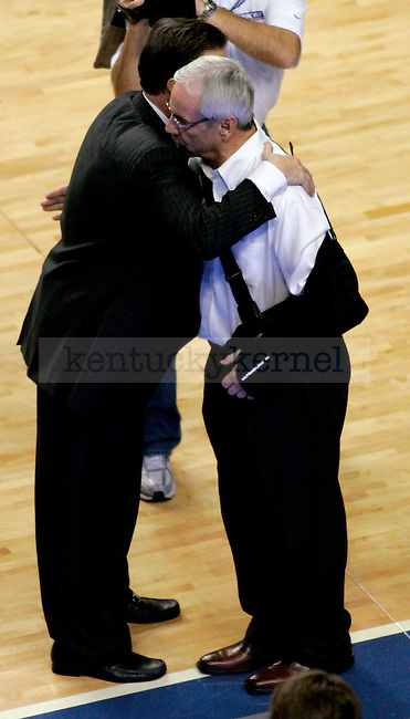 UK head coach John Calipari and UNC head coach Roy Williams exchange a hug after UK beat UNC 68-66 on Saturday, Dec. 05, 2009 at Rupp Arena. The win broke a five-year losing streak the Cats had to UNC.