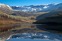 "20/01/16<br /> <br /> Kinder Scout reflected in Kinder Reservoir.<br /> <br /> Only 160 miles, as the crow flies from central London, Will Flanagan (36), explores the stunning icicles at Kinder Downfall near Hayfield in the Derbyshire Peak district today. After days of cold sub-zero temperatures the 100 ft waterfall finally froze over last night.<br /> <br /> Will said: ""I had to set off at dawn to to get up here. I've been watching the overnight temperatures and thought there's be a chance it would be frozen today. <br /> <br /> ""As the sun began to rise the ice started to melt. I could here it cracking beneath my feet and I saw a few giant icicles crash down. So I didn't stay up there very long!<br /> <br /> ""I definitely wouldn't have wanted to climb any higher up it today even if I'd had ropes with me - the ice wouldn't have been strong enough to support me. If I'd have arrived any later I wouldn't have risked going all the way up. <br /> <br /> ""But all the same it was an awesome spectacle and one of the most extreme walks I've ever done.""<br /> <br /> The waterfall flows from Kinder Scout the only mountain in the Derbyshire Peak District between Hayfield and Edale. <br /> <br /> All Rights Reserved: F Stop Press Ltd. +44(0)1335 418365   www.fstoppress.com."