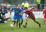 Brechin v St Johnstone....12.03.11  Scottish Cup Quarter Final.Murray Davidson fends off Ewan Moyes.Picture by Graeme Hart..Copyright Perthshire Picture Agency.Tel: 01738 623350  Mobile: 07990 594431