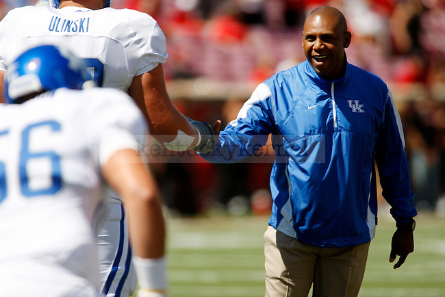 UK head coach Joker Phillips works with his team before iUK's 23-16 win over U of L, kicking off  Phillip's reign as head coach on Saturday, September 5, 2010. Photo by Britney McIntosh | Staff