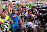 Napoli's Edinson Cavani  celebrates past photographers, victory and the qualification of the SSC Napoli team in the UEFA Champions League during the Italian Serie A football match between SSC Napoli and Siena at the San Paolo stadium in Naples.NAPOLI CACIO FESTA QUALIFICAZIONE  CHAMPIONS