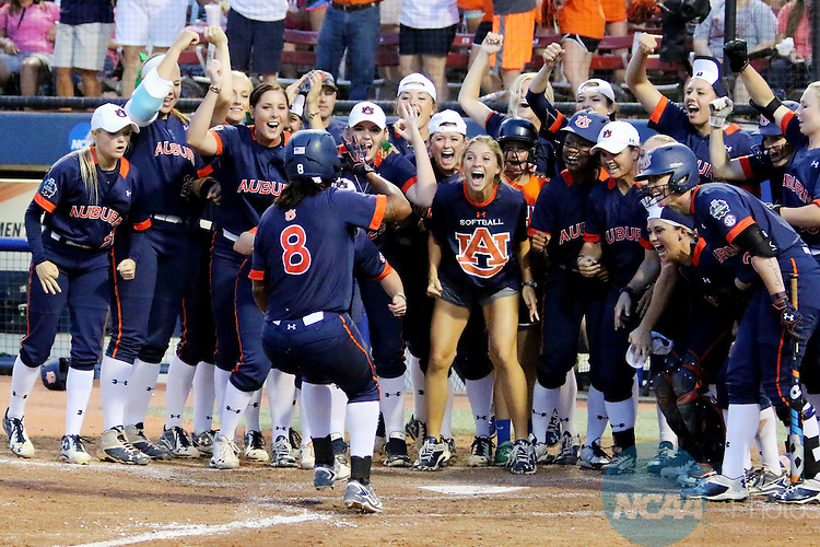06 JUNE 2016: Jade Rhodes (8) of Auburn University leaps into home plate and celebrates with teammates after slugging a home run against University of Oklahoma during the Division I Women's Softball Championship held at ASA Hall of Fame Stadium in Oklahoma City, OK. University of Oklahoma defeated Auburn University in Game 1 by the final score of 3-2. Shane Bevel/NCAA Photos