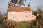 Pretty pink washed rural cottage, Marlesford, Suffolk, England