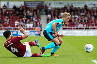 Fleetwood Town's Kyle Dempsey escapes a tackle from Northampton Town's Yaser Kasim <br /> <br /> Photographer Andrew Kearns/CameraSport<br /> <br /> The EFL Sky Bet League One - Northampton Town v Fleetwood Town - Saturday August 12th 2017 - Sixfields Stadium - Northampton<br /> <br /> World Copyright &copy; 2017 CameraSport. All rights reserved. 43 Linden Ave. Countesthorpe. Leicester. England. LE8 5PG - Tel: +44 (0) 116 277 4147 - admin@camerasport.com - www.camerasport.com