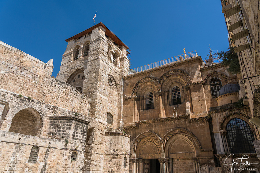 The 12th Century Crusader bell tower and the facade of the Church of the Holy Sepulchre in the Christian Quarter of the Old City of Jerusalem.  The Old City of Jerusalem and its Walls is a UNESCO World Heritage Site.  This church was built over the site believed by many to be location of the death and burial of Jesus Christ.  Below the window at right center is the Immovable Ladder.