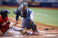 Tampa Bay Rays Rafelin Lorenzo (89) tags out Nick Hamilton (41) sliding into home during an instructional league game against the Boston Red Sox on September 24, 2015 at Tropicana Field in St Petersburg, Florida.  (Mike Janes/Four Seam Images)