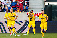 Federico Higuain (33) of the Columbus Crew celebrates scoring with Matías Sanchez (8). The New York Red Bulls and the Columbus Crew played to a 2-2 tie during a Major League Soccer (MLS) match at Red Bull Arena in Harrison, NJ, on May 26, 2013.