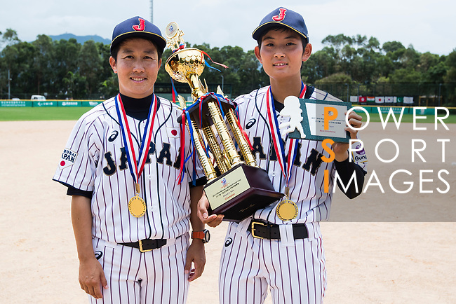 Head coach Kitta Megumi #57 (L) and Infielder Yoshii Harue #52 (R) of Japan, the best shortstop of the All-Star Team awards, pose for photo with medal and trophy during the BFA Women's Baseball Asian Cup Presentation Ceremony at Sai Tso Wan Recreation Ground on September 7, 2017 in Hong Kong, China. Photo by Yu Chun Christopher Wong / Power Sport Images